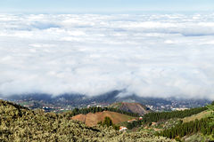 White clouds. Beautiful amegine view from peak of mountains Gran Canaria island. Stock Photos