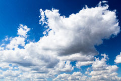 White clouds in the beautiful dark blue sky. That can be used as a background and in different other projects Stock Photos