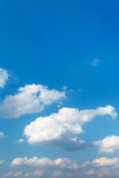 White clouds in blue afternoon sky in summer Stock Photos