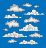White clouds on a blue background. Drawing by hand. Royalty Free Stock Image