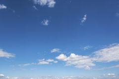 White clouds on the blue clear sky. Stock Image