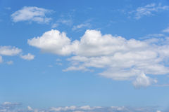 White clouds on the blue clear sky. Stock Photos