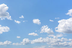White clouds on the blue clear sky. Royalty Free Stock Photos