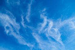 Clouds on a blue sky. White clouds on a blue day sky Royalty Free Stock Images