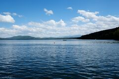 White Clouds and Blue Skies over Lake Royalty Free Stock Photo