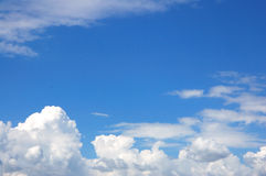 White clouds on a blue sky Stock Photos