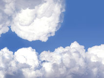 White clouds in blue sky. Scenic view of white cloudscape formations in blue sky with copy space Royalty Free Stock Photos