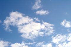 White clouds in blue sky. Bright day as a natural background Royalty Free Stock Photos