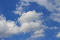 White clouds. In the blue sky Royalty Free Stock Image