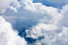 White clouds on blue sky background close up, cumulus clouds high in azure skies, beautiful aerial cloudscape view from above. Sunny heaven landscape, bright stock image