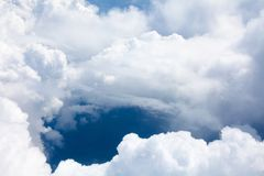 White clouds on blue sky background close up, cumulus clouds high in azure skies, beautiful aerial cloudscape view from above. Sunny heaven landscape, bright royalty free stock image