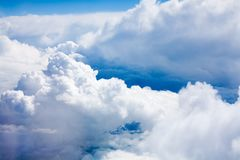 White clouds on blue sky background close up, cumulus clouds high in azure skies, beautiful aerial cloudscape view from above. Sunny heaven landscape, bright royalty free stock images