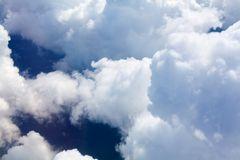 White clouds on blue sky background close up, cumulus clouds high in azure skies, beautiful aerial cloudscape view from above stock photos