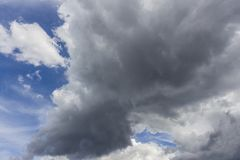 White clouds in blue sky background. Sky from Latin caelum, from caelum tangi: being-touched-wounded by lightning is often defined as the space in which the stock images