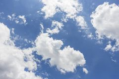 White clouds in blue sky background. Sky from Latin caelum, from caelum tangi: being-touched-wounded by lightning is often defined as the space in which the stock photography