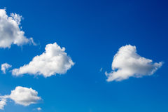 White clouds on blue sky background. In sunny day summer time royalty free stock photography