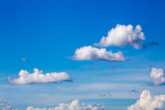 White clouds on blue sky background. In sunny day summer time Stock Photos