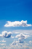 White clouds on blue sky background. In sunny day summer time stock images