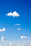 White clouds on blue sky background. In sunny day summer time Royalty Free Stock Photo