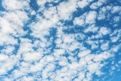White clouds on blue sky background. Vibrant outdoors horizontal image with copy space Stock Photo