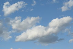 White Clouds in Blue Sky Stock Images