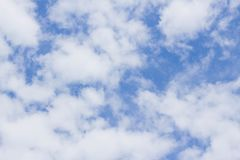 White clouds in the blue sky. White clouds in the bright blue sky, background, horizon, summer, light, beautiful, heaven, clear, morning, pattern, day, air royalty free stock image