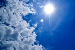 White clouds in the blue sky. Blue sky with white clouds and bright shining sun Royalty Free Stock Image