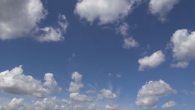 White clouds in the blue sky stock footage