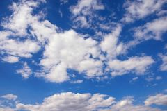 White clouds in blue sky. White fluffy clouds in blue sky, background Stock Images
