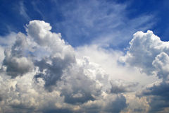 White clouds in the blue sky. White fluffy clouds in the clean blue sky Royalty Free Stock Image