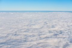 White clouds with blue sky and horizon in beautiful day, above view from air plane. White cloud with blue sky and horizon in beautiful day, above view from air Royalty Free Stock Images