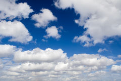 White clouds on blue sky horizontal background Stock Photos