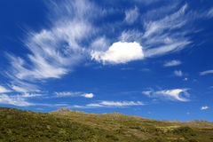 White clouds in blue sky with mountains. White windblown clouds with blue sky in the mountains in Kosciuszko National Park NSW Australia Stock Photography