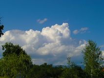 White clouds on the blue sky. In nature stock photos