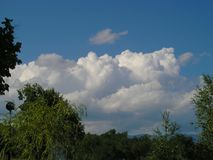 White clouds on the blue sky. In nature stock images