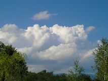 White clouds on the blue sky. In nature stock image