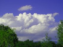 White clouds on the blue sky. In nature stock photography