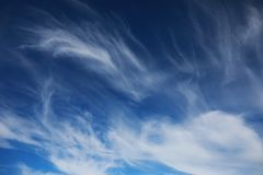 White clouds in a blue sky Stock Image