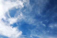 White clouds in a blue sky Stock Images