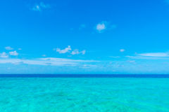 White clouds with blue sky over calm sea  in tropical Maldives i Stock Photography