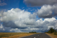 White clouds and blue sky over the road Stock Images