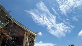 White clouds and blue sky over under construction temple. Thai architecture and religion culture Royalty Free Stock Images