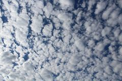 White Clouds with Blue Sky Pattern/Background Stock Images