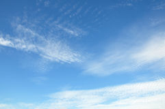 White clouds on the blue sky. Ripple Stock Images