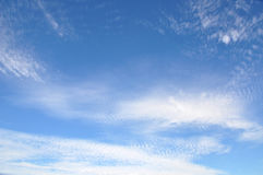 White clouds on the blue sky. Ripple Royalty Free Stock Photos