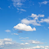 White clouds in blue sky in summer day. Fluffy cumulus cloud in blue sky under stratus clouds Stock Photos