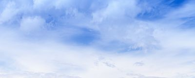 White clouds in blue sky at summer day stock image