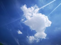 White clouds and blue sky in summer stock photo