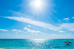 White clouds with blue sky and sun over calm sea  in tropical Ma Stock Photo
