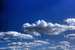 White clouds. Sunny day. Royalty Free Stock Photo
